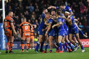 Leeds Rhinos celebrate Brad Dwyer's golden-point drop goal winner at home to Castleford Tigers last year. Picture by Jonathan Gawthorpe.