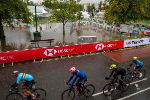 The men's cycling race passes the waterlogged Stray.