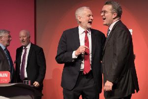 Labour leader Jeremy Corbyn is pictured with deputy leader Tom Watson who today announced his resignation.