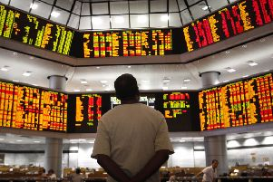 Watching the market: Warning signs from China, Europe and the US lead some to believe a downturn is overdue. PHOTO: AP Photo/Vincent Thian