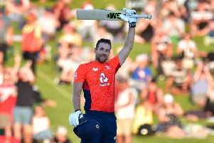 England's Dawid Malan celebrates 100 runs during the Twenty20 cricket match between New Zealand and England at McLean Park in Napier (Picture: MARTY MELVILLE/AFP via Getty Images)