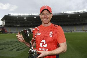 It's ours: England captain Eoin  Morgan with the trophy.