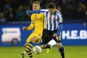 Back in the thick of it: Fernando Forestieri holds off Matt Grimes. Picture: Steve Ellis