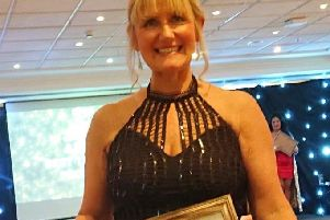 Suzy Orr with her award