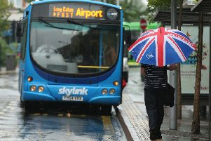 A man in Nottingham runs through the rain to catch the bus to the East Midlands Airport. Picture:''Tom Maddick /SWNS