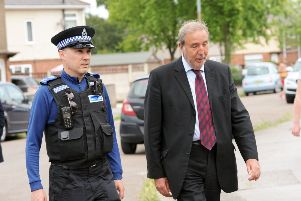 The Nottinghamshire Police and Crime Commissioner, Paddy Tipping, right, and PCSO Keith Crowhurst, pictured on their walkabout around Bilsthorpe on Monday.