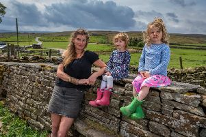 Amanda Owen, the Yorkshire Shepherdess, of Ravenseat Farm, North Yorkshire.  with two of her nine children Nancy and Clemmy. Picture: James Hardisty.