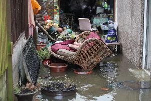 Belongings sit in floodwater outside a house  in Fishlake, Doncaster.