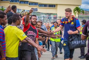 Elliott Whitehead meets locals after flying into PNG with Great Britain.