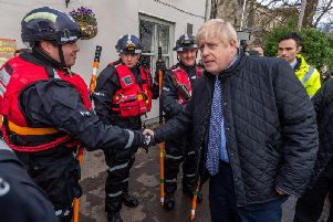 The prime minister Boris Johnson, arriving at St Cuthbert's Church, Fishlake, near Doncaster, chatting Yorkshire and Humber Regional Marine Underwater Search Unit. Photo: JPI Media