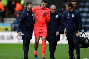 Huddersfield Town's Tommy Elphick is helped from the field after injuring his knee against Preston North End on Saturday