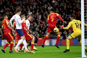 Harry Kane heads the first of his three goals in England's 7-0 Euro 2020 qualifying win at home to Montenegro