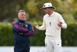 Experienced advice: Darren Gough talks to Stuart Broad. Picture: Getty Images