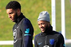 WATER UNDER THE BRIDGE: England's Joe Gomez (left) and Raheem Sterling during training at St George's Park. Picture: Mike Egerton/PA
