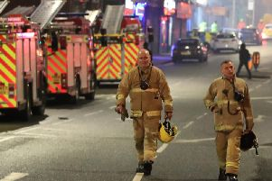 Fire fighters at the scene after a fire on the top floors of a building on Bradshawgate in Bolton. Picture date: Friday November 15, 2019.Photo credit: Peter Byrne/PA Wire