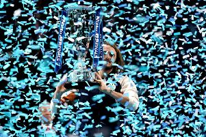 Stefanos Tsitsipas celebrates with the trophy after winning against Dominic Thiem.