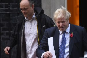 Boris Johnson with his chief of staff Dominic Cummings (left).
