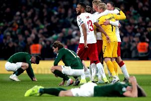 Republic of Ireland's Jeff Hendrick (centre left) appears dejected as Denmark's Kasper Schmeichel (1) and Mathias Jorgensen (13) celebrate victory with team-mates after the UEFA Euro 2020 Qualifying match at the Aviva Stadium, Dublin.(Picture: PA).