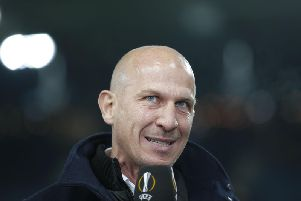 Gerhard Struber talking on television after a Wolsberger game in the Europa League.