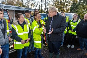 Boris Johnson meets response teams in flood-hit South Yorkshire. Pic: James Hardisty