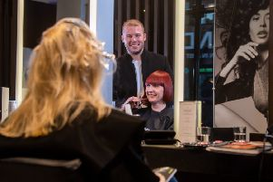 Hairdresser of the Year 2019 nominee Robert Eaton, pictured with clients at the Leeds Russell Eaton salon. 'Picture James Hardisty.