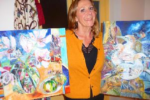 Josie Baraclough with her paintings titled Pink Cosmos (Flowers) and Gannets