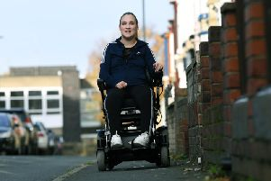 Tiffany Pearson from Whitby, who was paralysed at 18 by a narrowing of her spinal cord. This month she marks a decade since she lost use of her legs, but she is finally in a good place both physically and mentally and now in an electric wheelchair, helping her with independence and freedom. Image: Jonathan Gawthorpe.