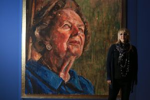 Lorna May Wadsworth next to her portrait of Margaret Thatcher, part of her retrospective, Gaze, at the Graves Gallery in Sheffield.