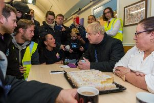 A defining image of this election - James Hardisty's photo of Boris Johnson meeting flooding victims in Fishlake.