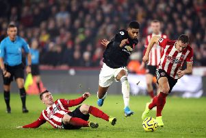 In pursuit: Phil Jagielka, right, enjoyed his tussle with Manchester United's Marcus Rashford.
