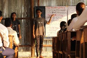 A group of secondary school pupils in Cambodia, attend a workshop led by ICS volunteers. Photo: ICS/Otdam Hor