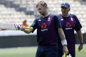 Ready to hit back: England's Joe Root gestures with his bat as coach Chris Silverwood watches.