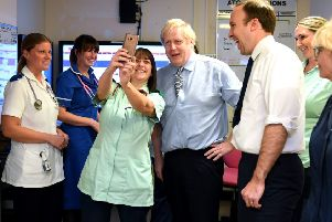 Boris Johnson and Matt Hancock (right) have been told to put the care of patients before targets.