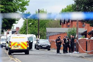 Police at the crime scene following the murder of Christopher Lewis on Reginald Street, Chapeltown.