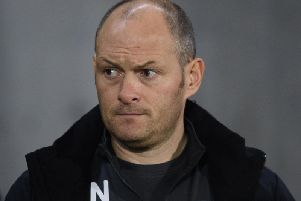 Preston boss Alex Neil looks stern faced as his side are beaten 4-0 at Hull City.