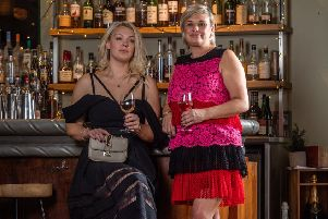 In the bar at Hotel du Vin in Harrogate, wearing pre-owned fashion by The Pod, Alex, left, wears: Off shoulder dress, �160, Self Portrait; clutch bag, �150, Valentino.'Cath wears: Lace tiered dress, �180, Philosophy; shoes, �80, Aquazurra'. Picture James Hardisty.