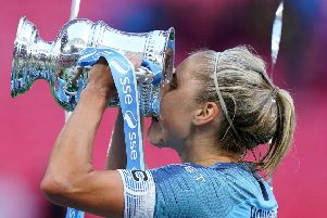 The prize: Manchester City Women's Steph Houghton celebrates with the trophy after the Women's FA Cup Final at Wembley Stadium, where they defeated West Ham.