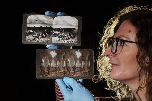 Leeds artist Helen Dryden with original First World War stereogram photographs from the Leeds City Museum collection. 'Helen has worked with a small group of volunteers and has used the historic photos taken on the front lines To create moving 3D images. 'Picture: Tony Johnson