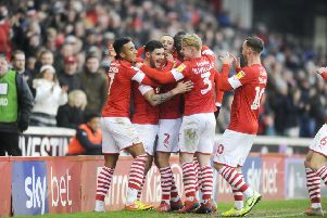 Barnsley's Alex Mowatt celebrates after he fires home the opening goal. Picture: Dean Atkins