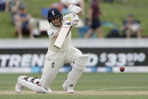 CLASS ACT: England's Joe Root drives through the covers on his way to a century on day three of the second Test against against New Zealand at Seddon Park. PIcture: AP Photo/Mark Baker