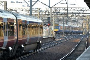 Trains coming in and out of Leeds train station.