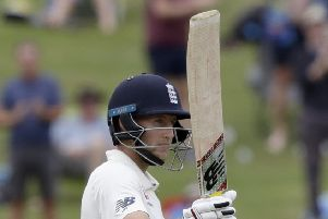 England's Joe Root gestures with his bat as he reaches 150 runs on day four of the second cricket test between England and New Zealand at Seddon Park in Hamilton, New Zealand (AP Photo/Mark Baker)