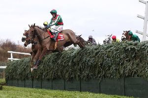 Vieux Lion Rouge and Tom Scudamore clear Becher's Brook in the 2016 Becher Chase. Photo courtesy of Aintree Racecourse and Grossick Racing Company.