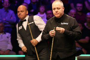 John Higgins (right) and Stuart Bingham during day eight of the Betway UK Championship at the York Barbican.