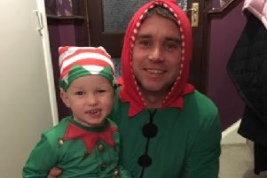 Lee Webb and his three-year-old son, Eric, dressed as elves on their festive rounds