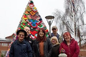 Members of the Kirkby Craft Bombers and Artful Buttoner staff with the crocheted Christmas tree at Ashfield District Council.
