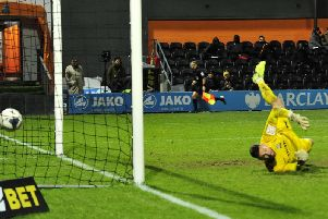 Danny Rowe's free-kick hits the net for the Fylde equaliser at Barnet   Picture: STEVE MCLELLAN