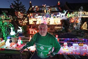 Eric Marshall in front of his Christmas lights display at his home in Bagby, North Yorkshire.