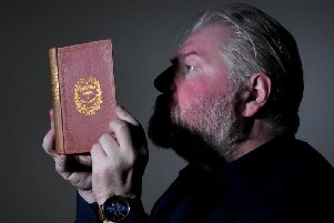 Richard High from the collections team at the Treasures of Brotherton Gallery looks at a first edition of A Christmas Carol, by Charles Dickens..10th December 2019.Picture by Simon Hulme