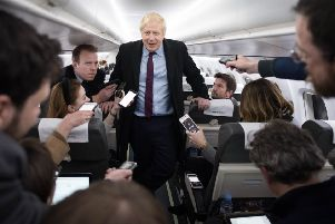 Prime Minister Boris Johnson speaks to the press on board his campaign plane this week.